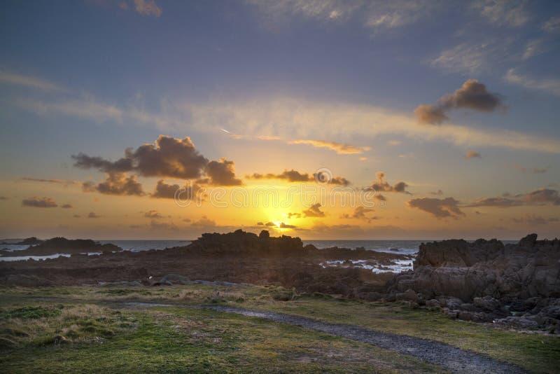 Coucher du soleil guernesey photographie stock libre de droits