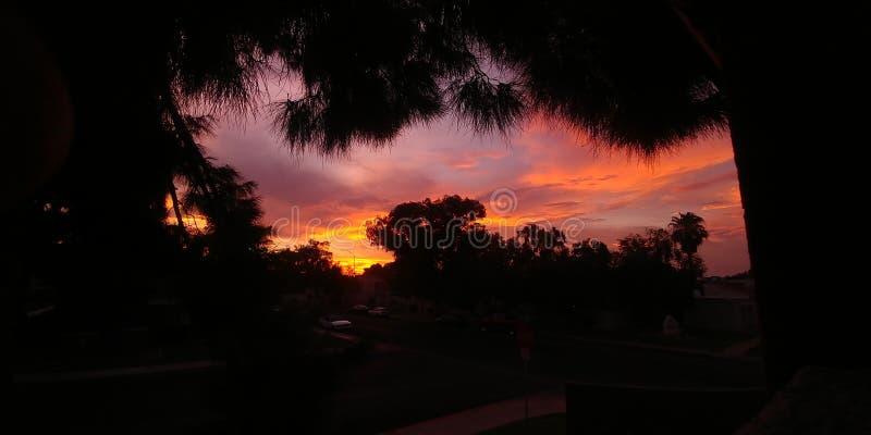 Coucher du soleil orange de ciel image stock