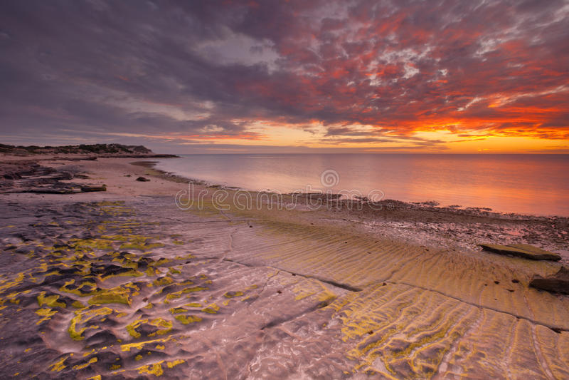 Coucher du soleil sur la côte de la chaîne NP, Australie occidentale de cap photographie stock libre de droits