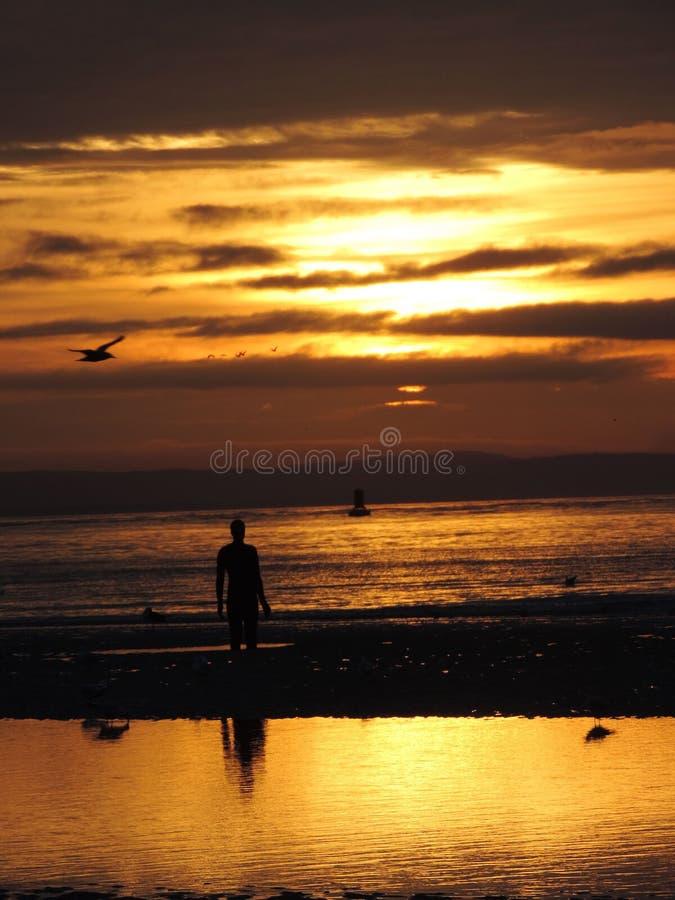 Coucher du soleil sur la plage de Crosby photographie stock