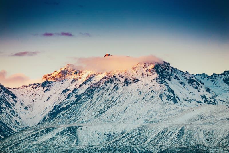 Coucher du soleil sur le sommet du Mt Faites cuire et La Perouse au Nouvelle-Zélande photographie stock
