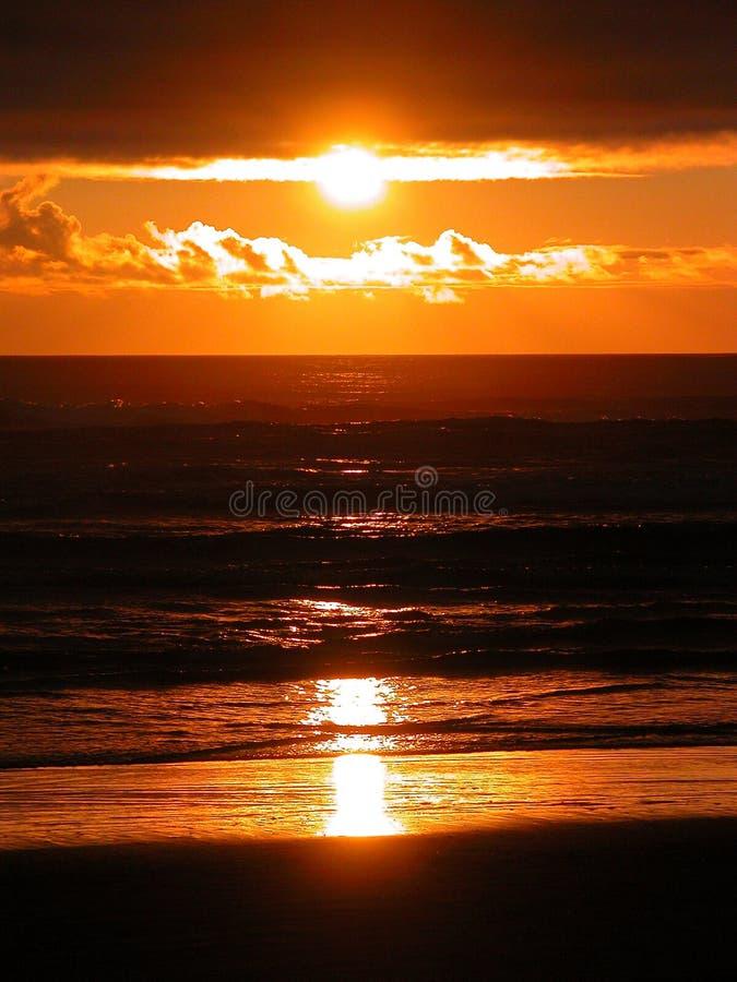 Couchers du soleil de flambage photo libre de droits