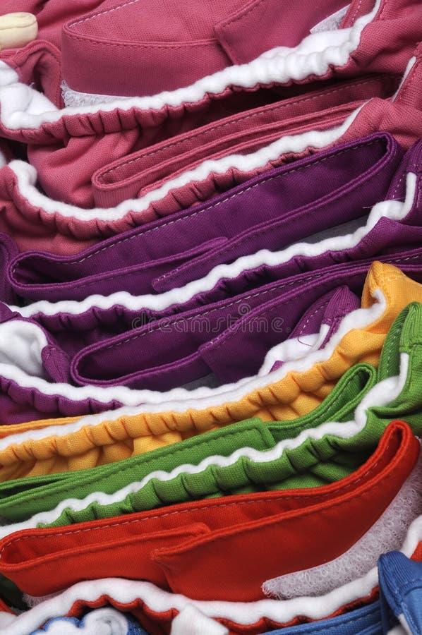 Couches-culottes amicales vibrantes de tissu d'Eco images stock