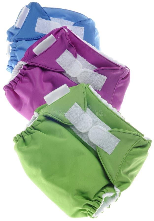 Couches-culottes de tissu en vert, pourpre et bleu photographie stock libre de droits