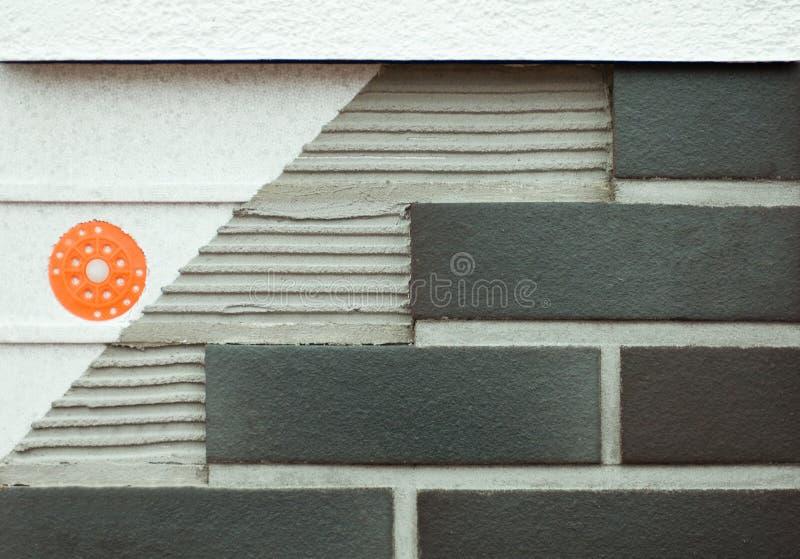 Couches d'une maison de brique   photo stock