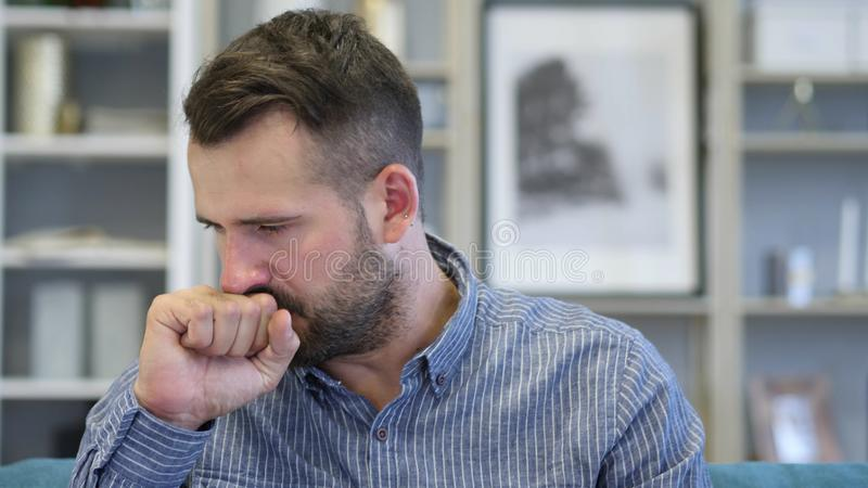 Cough, Portrait of Sick Adult Man Coughing at Work royalty free stock photo