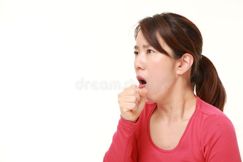 Coughing  japonais de femme photos stock