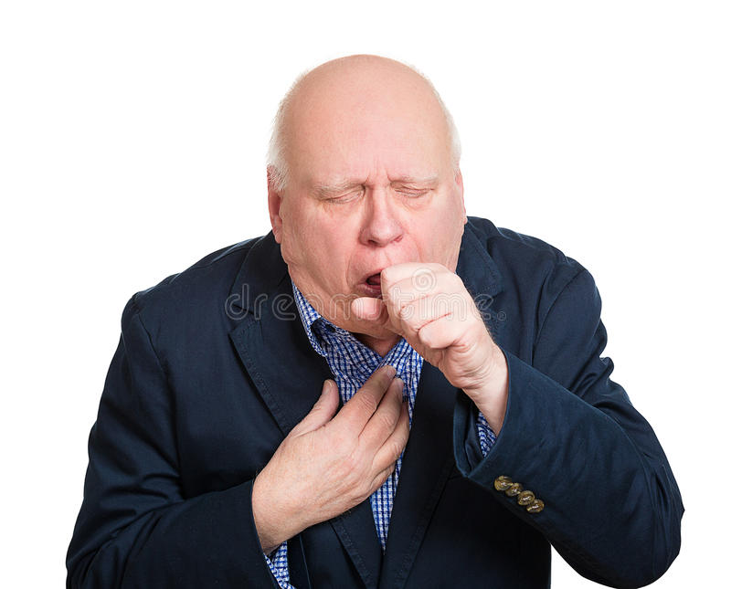 Coughing old man. Closeup portrait, sick old man, senior worker, elderly executive guy, having severe infectious cough, holding chest, raising fist to mouth royalty free stock photography