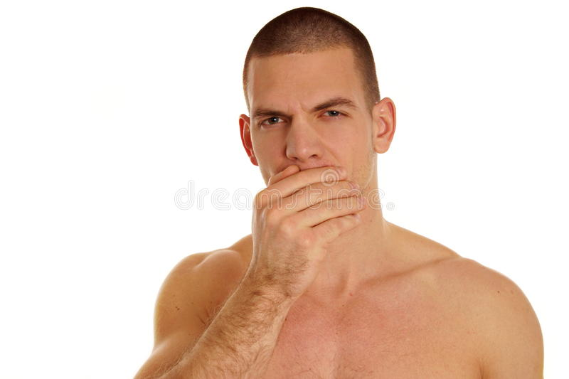 Coughing shirtless young man. Coughing sick shirtless young man on a white background royalty free stock photography