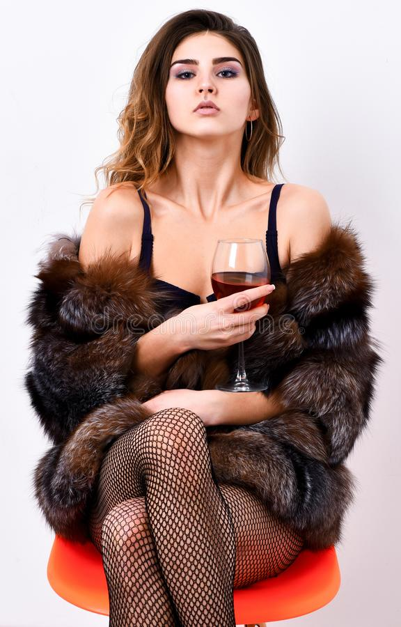Could be yours. Woman seductive model enjoy wine wear luxury fur and elite lingerie. Girl you dream about. Fashion lady stock photo