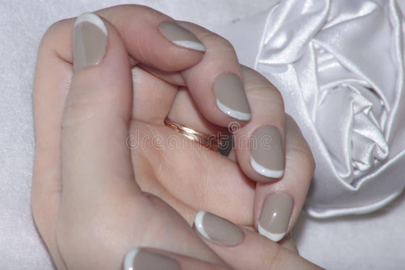 Couleur agréable douce de vernis à ongles photo libre de droits