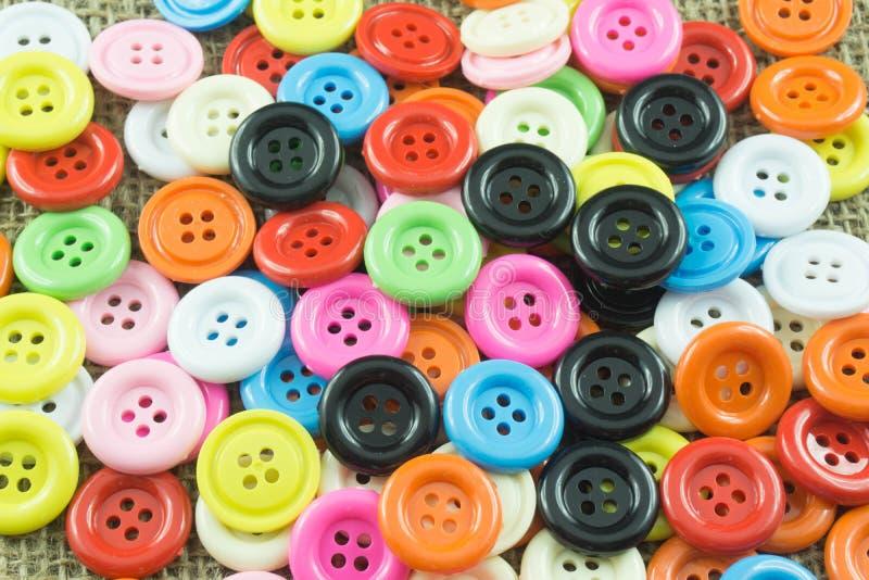 Couleur assortie de 4 boutons de trou images stock