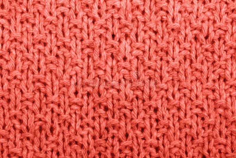 Couleur de corail vivante tricotée de texture de tissu image stock