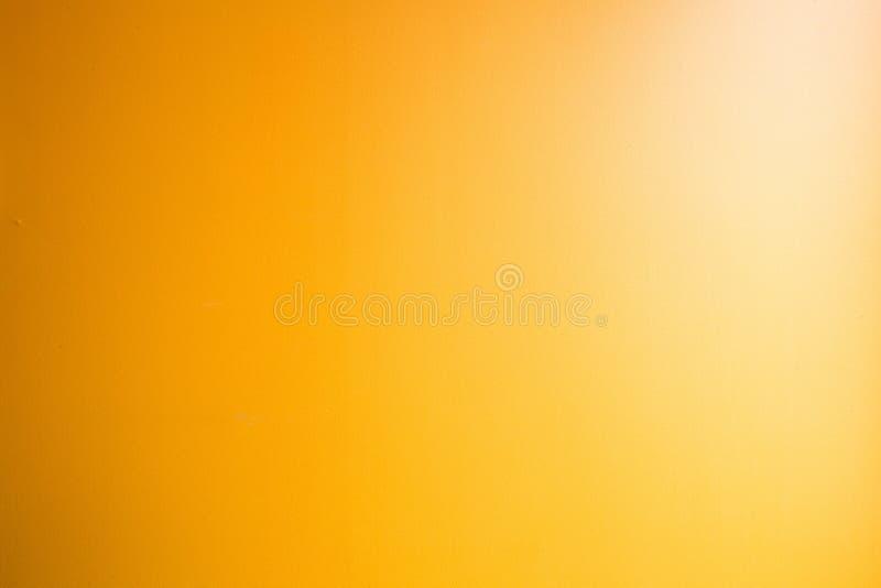 Couleur jaune de fond abstrait orange d'or, projecteur faisant le coin l?ger, fond orange faible de cru color? photo libre de droits