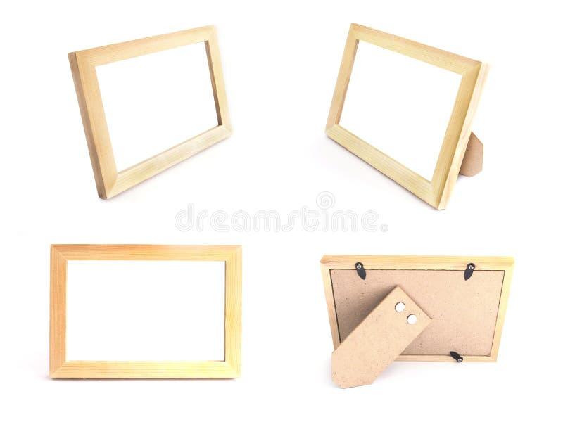 Couleur naturelle en bois de cadres de tableau pour se tenir sur la table au-dessus de W photo libre de droits
