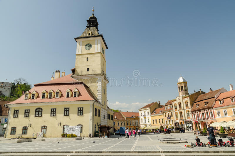 Council Square. BRASOV, ROMANIA - APRIL 27: Council Square on April 27, 2013 in Brasov, Romania. The Old Town includes the Black Church, Council Square and stock photography