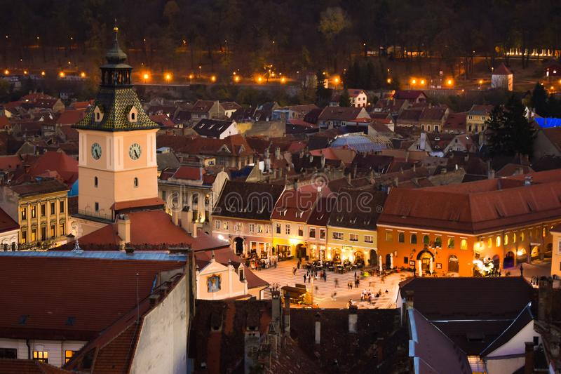 The Council Square of Brasov seen from above White Tower. Night view. The Council Square PiaÈ›a Sfatului in Romanian, former Marktplatz in German is located stock photography