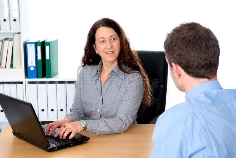 Counseling interview. Business women and men in counseling interview stock photos