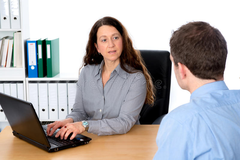 Counseling interview. Business women and men in counseling interview stock images