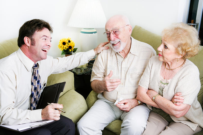 Counseling - Taking Sides. Male counselor taking sides with the husband against the wife stock image