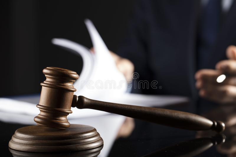 Counselor concept. Man signing documents. Gavel. Law concept royalty free stock images