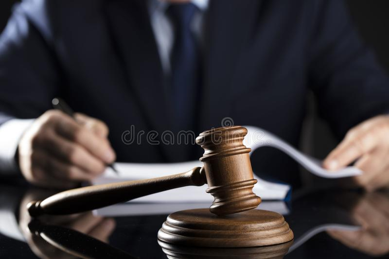 Counselor concept. Man signing documents. Gavel. Law concept royalty free stock photo