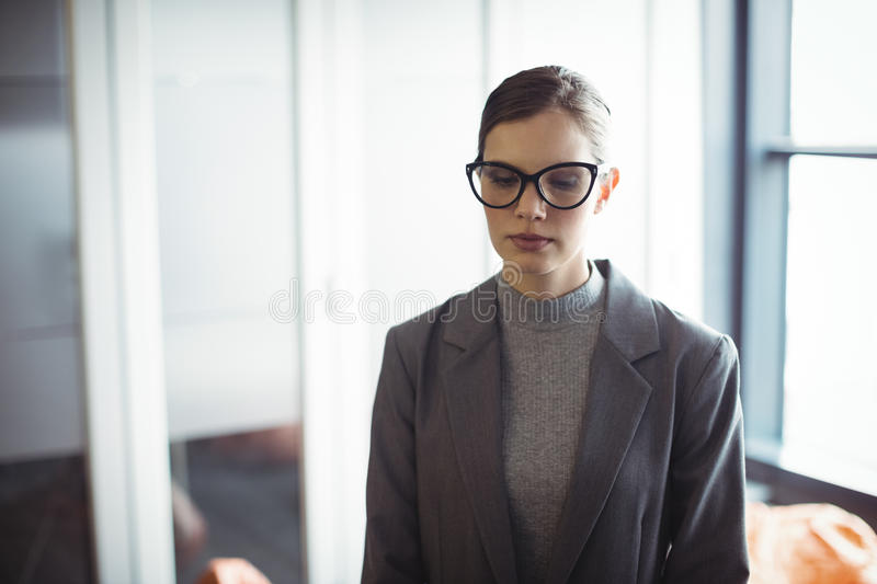 Counselor in glasses standing stock photos