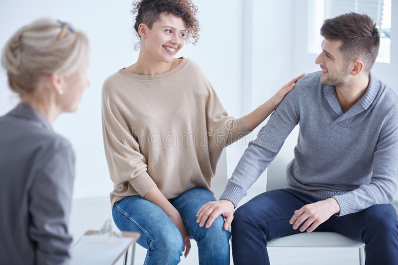 Counselor and happy couple stock image