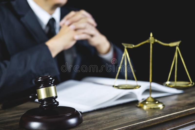 Counselor or Male lawyer working on courtroom sitting at the tab. Le. Legal law, Judge gavel with Justice lawyers advice with gavel and Scales of justice stock image