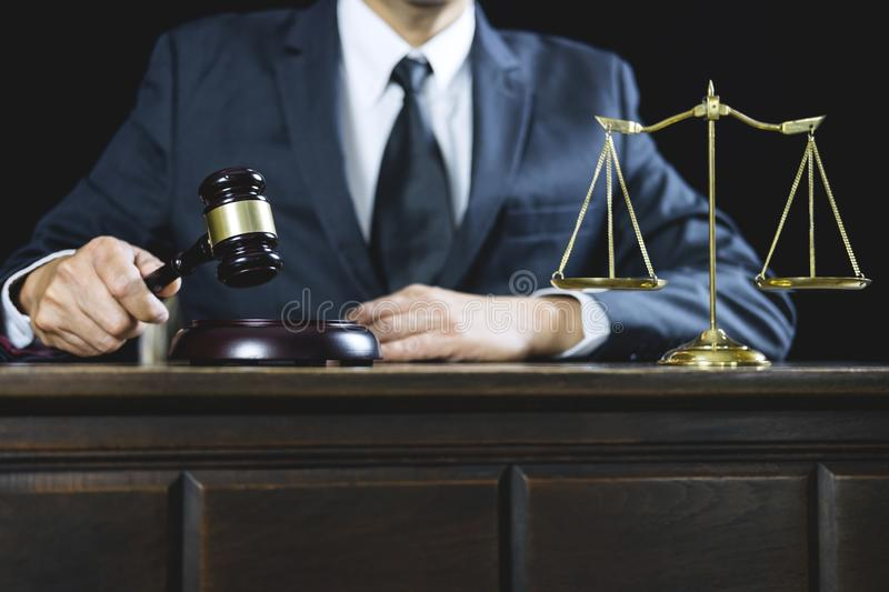 Counselor or Male lawyer working on courtroom sitting at the table. Legal law, Judge gavel with Justice lawyers advice with gavel. And Scales of justice stock photography