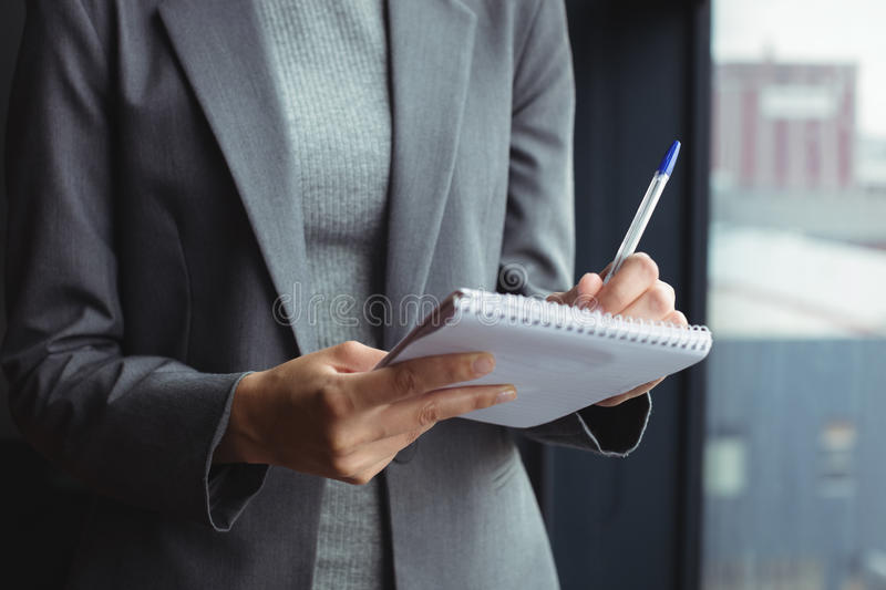 Counselor at office taking notes royalty free stock photography