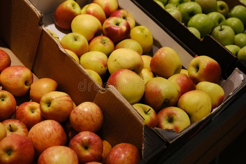 Counter in apples in a supermarket. Many kinds of apples stock photo