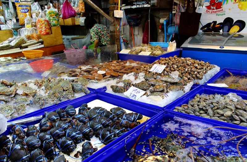 Counter with seafood in the Thai market royalty free stock image