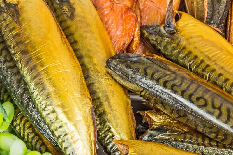 Smoked fish in market. Counter with smoked fish in assortment stock photos