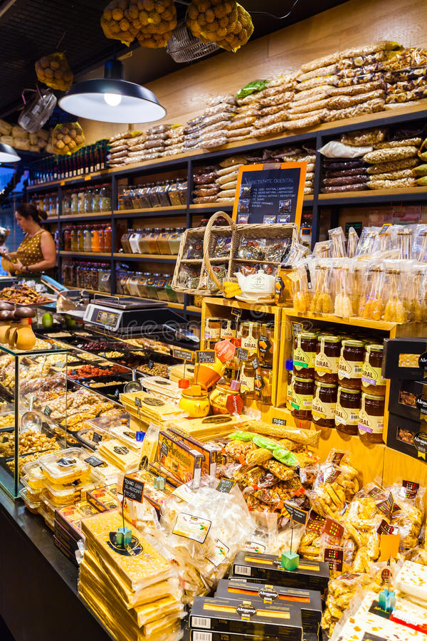 Counter with spices and sweets at Boqueria Market in Barcelona. stock photography