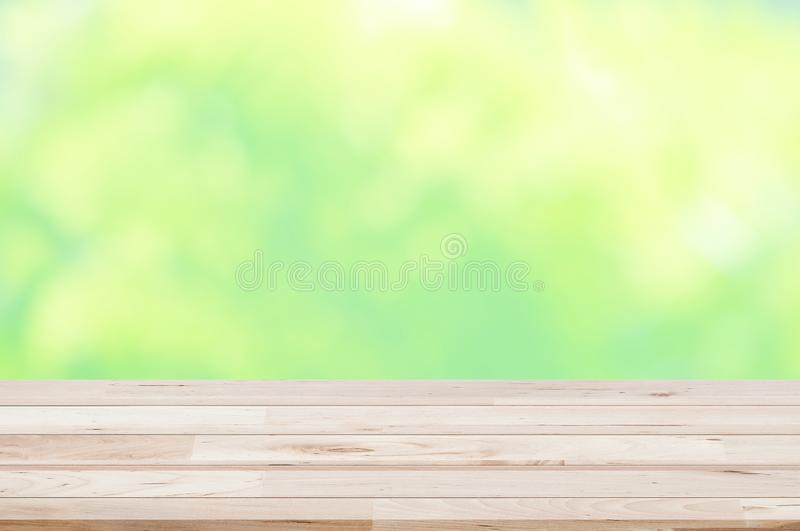 Counter top,perspective light brown deck wooden texture natural color with blurred green,garden,outdoor background used for montag stock photo