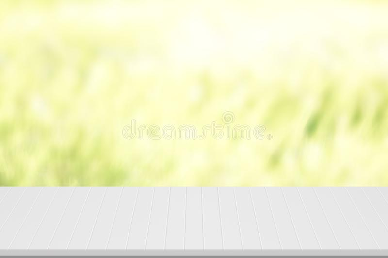 Counter top,perspective white deck wooden groove line texture spray white color with blurred green,garden background used for mont stock photography