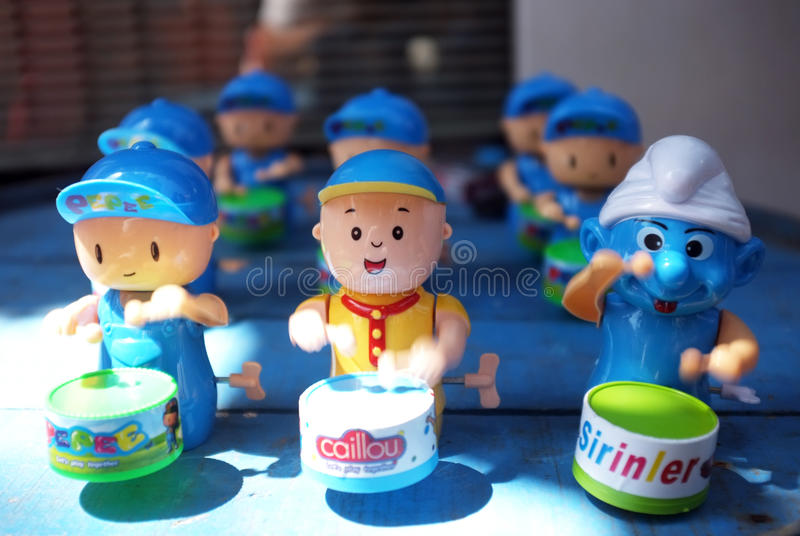 Counterfeit drum playing toys stock images