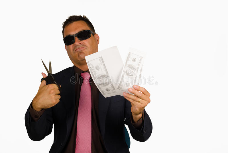 Counterfeiting dollars. Macho type of guy counterfeiting dollar bank notes stock image