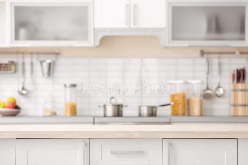 Countertop and blurred view of kitchen interior royalty free stock images