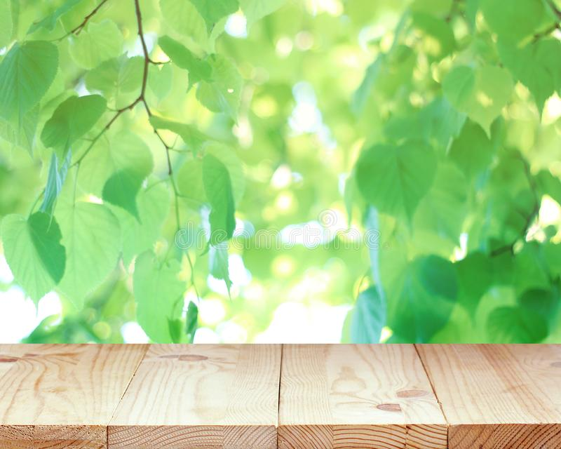 Countertop, work surface, empty wooden table on a blurred spring background stock photography