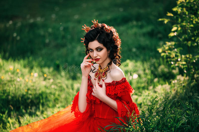 Countess in a long red dress royalty free stock images