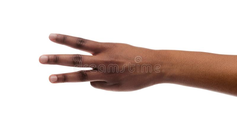 Female hand showing number three with fingers on white background royalty free stock photos