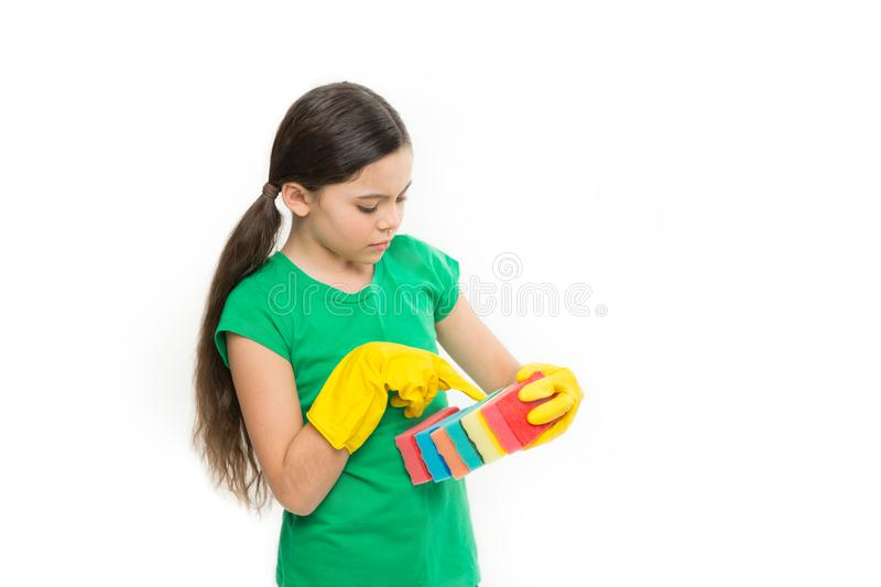 Counting her kitchen sponges. Adorable kitchen maid. Household duties. Small housekeeper holding dish sponges in rubber royalty free stock photo
