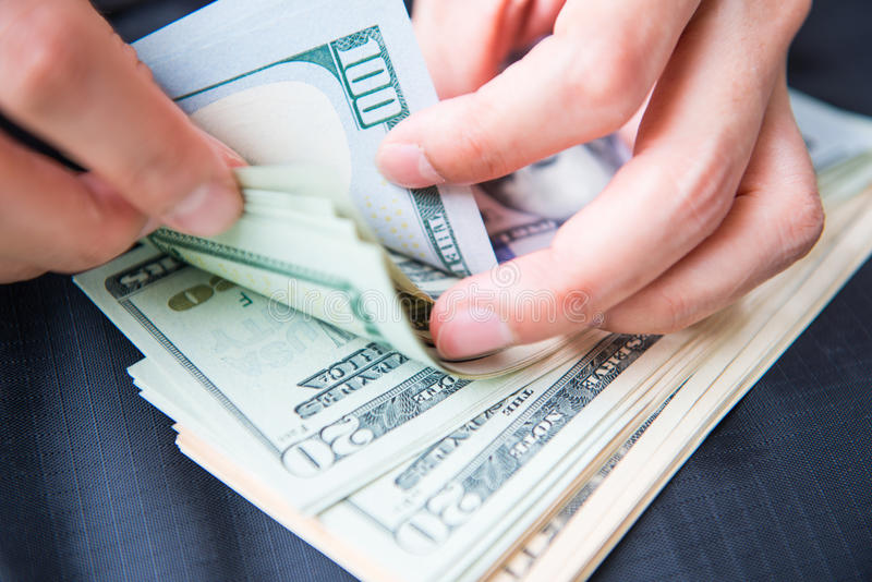 Counting money American dollars with hand. Cash royalty free stock image