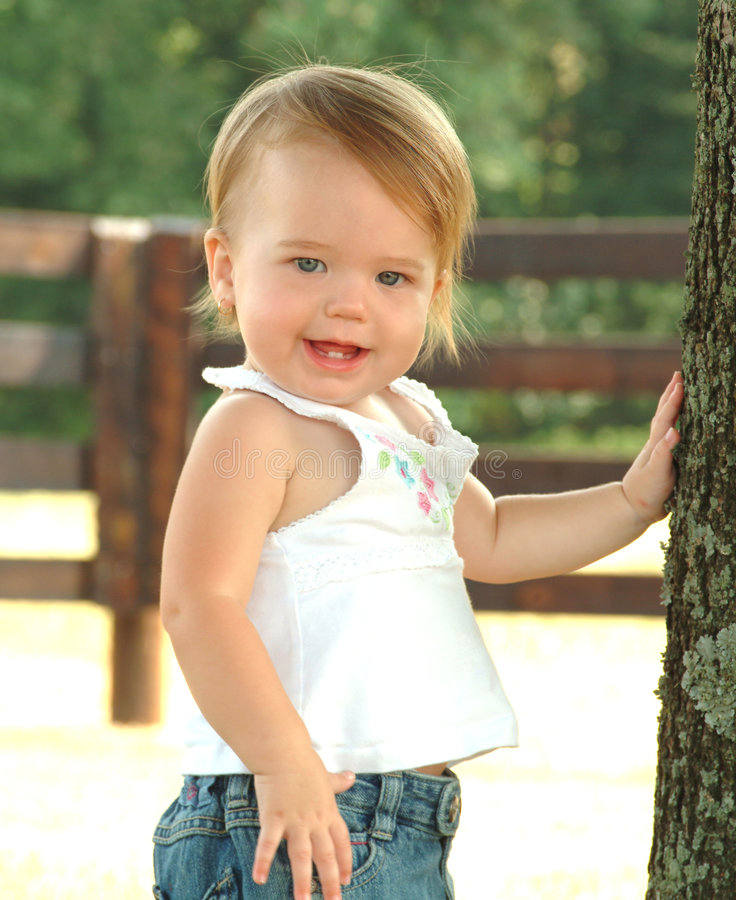 Country Baby. Baby girl in country setting royalty free stock images