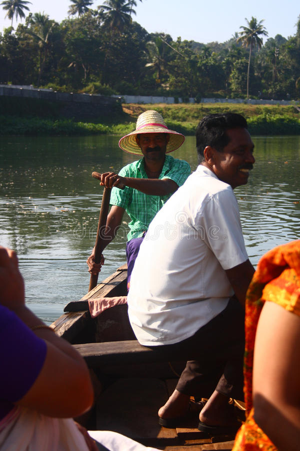 Country Boat Driver Transporting People Over River Editorial Photography