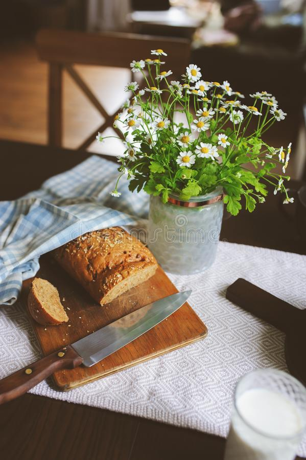 Country breakfast on rustic home kitchen with farm eggs, butter, wholegrain bread and milk. stock photos