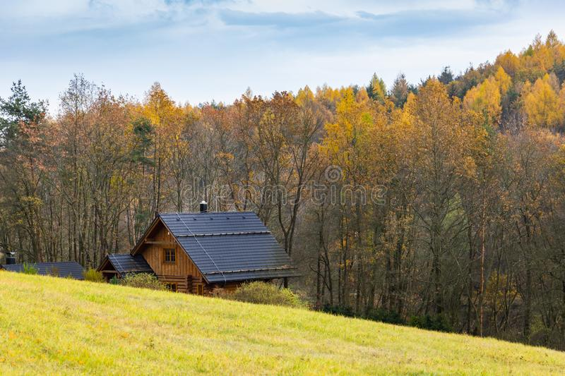 A country cabin in South Bohemia in Autumn with yellow trees.  royalty free stock images
