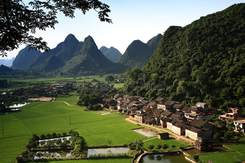Country in china guilin. Blue china east farm green guilin mountain old sky town tree water stock photo